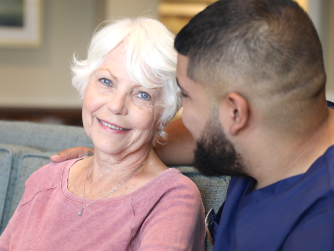 a male worker spends time with senior female respite client