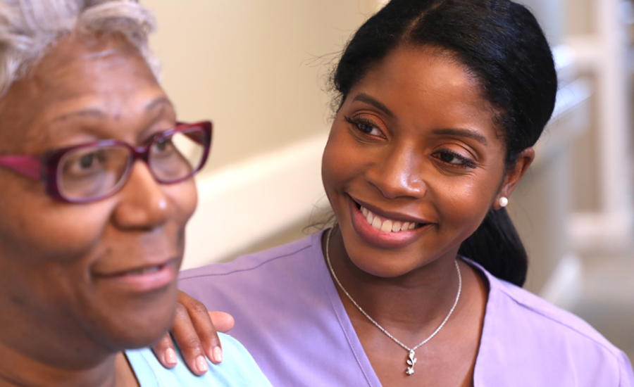 young female home healthcare woman discusses plan with senior woman