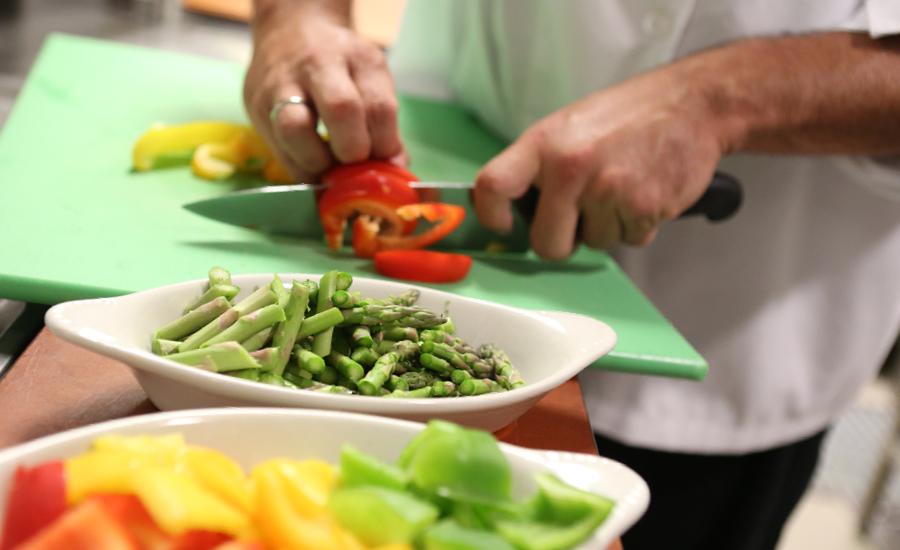 close up view of chef preparing royal atrium inn restaurant style meal