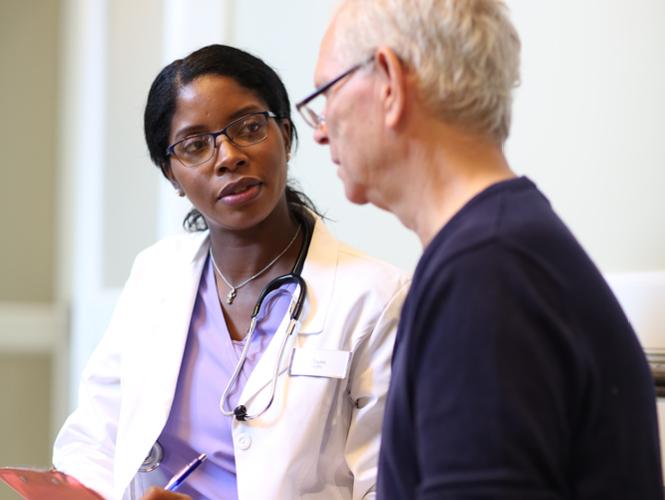 female doctor explains care plan to senior male patient