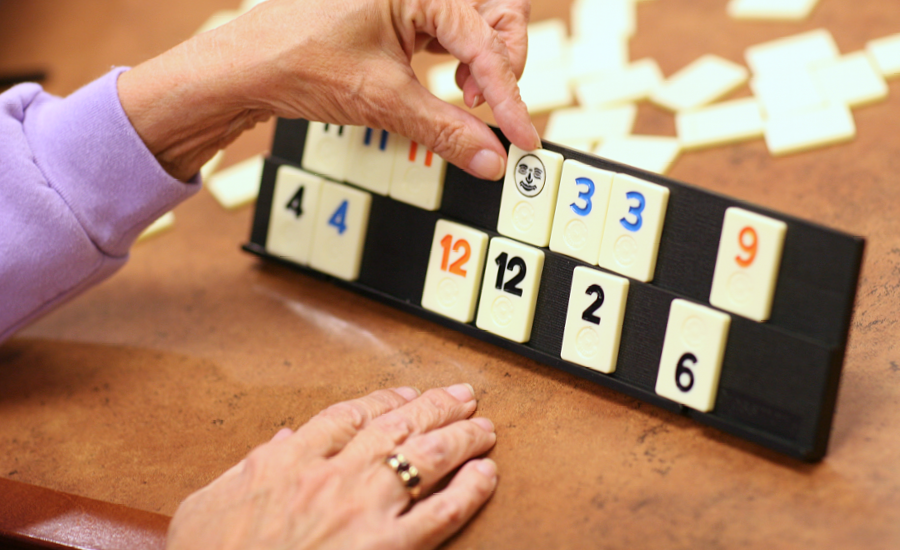 hands of a providence respite client are shown playing rummikub