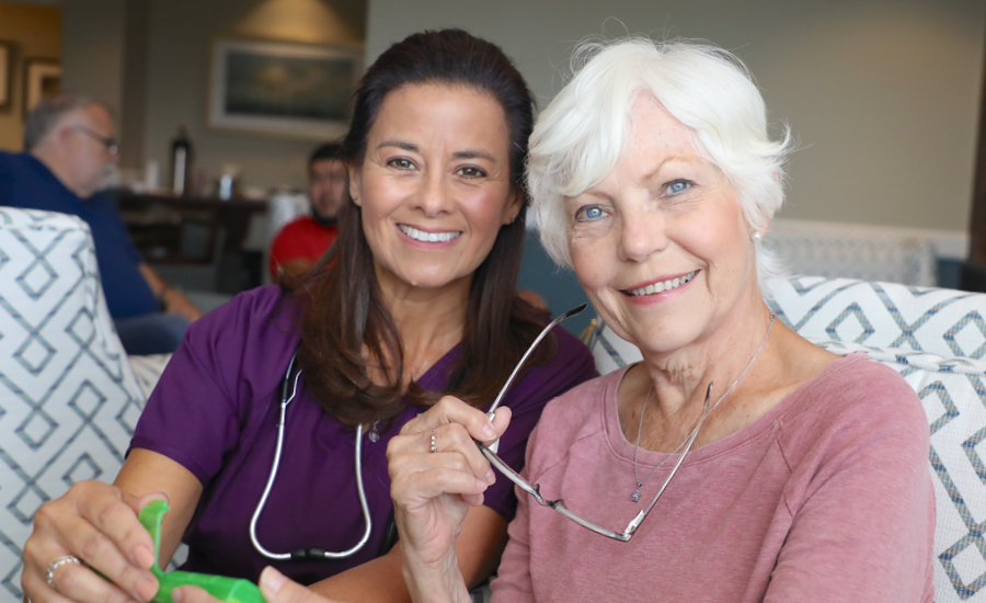 female geriatric care manager smiles with park place resident