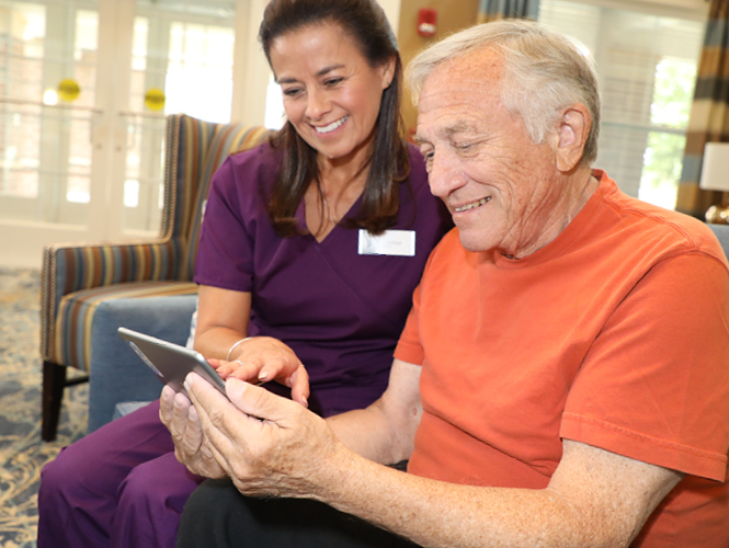 a cna helps a memory care resident with care plan at emerald meadows