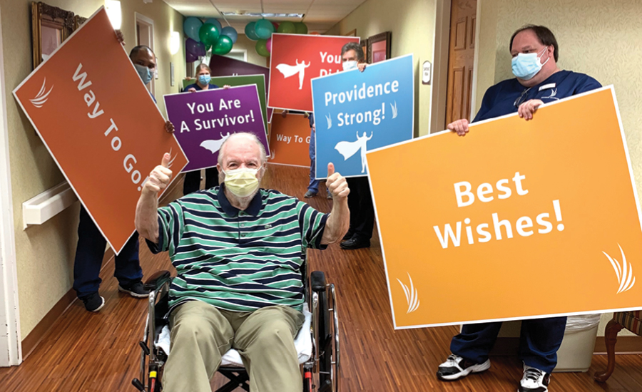 Recovered COVID patient celebrates being discharged with caregivers