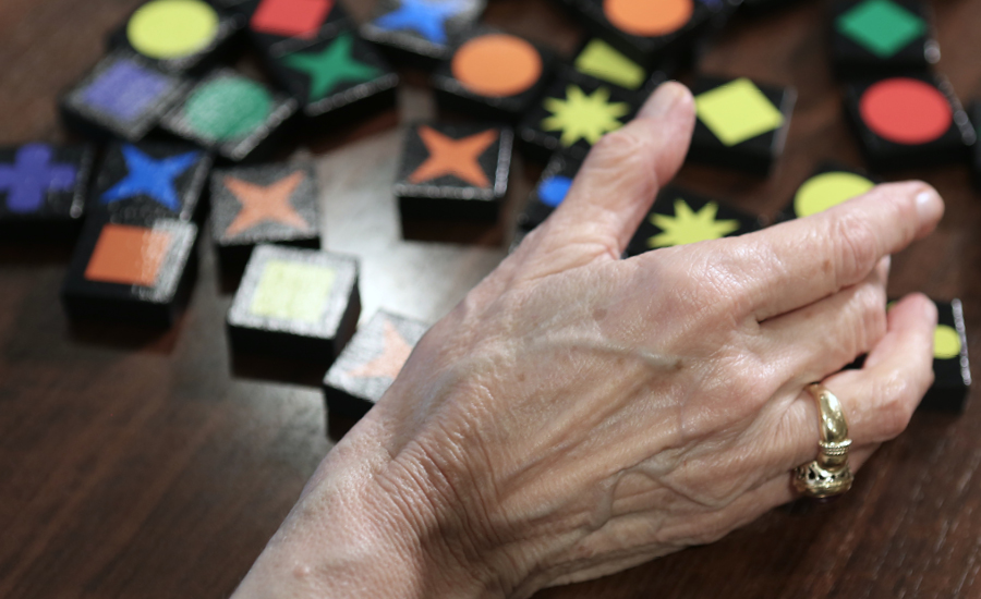 Woman's hand and puzzle in memory care