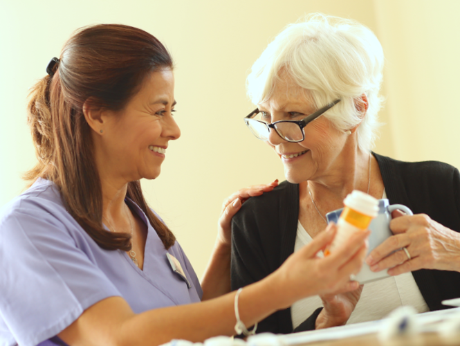 a female CNA helps female transition to home resident with medication