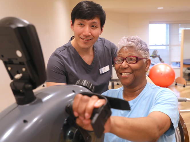 male rehabilitation therapists works with senior female