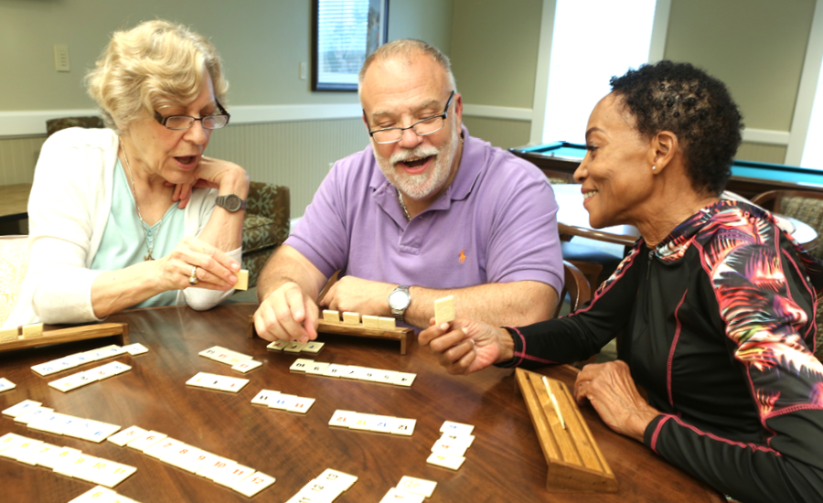 three senior residents play rummikub