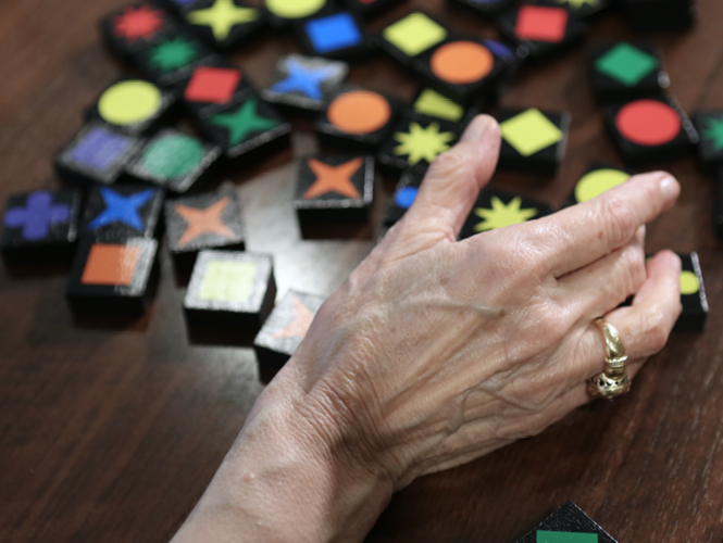 close up of woman's hands completing memory care activity