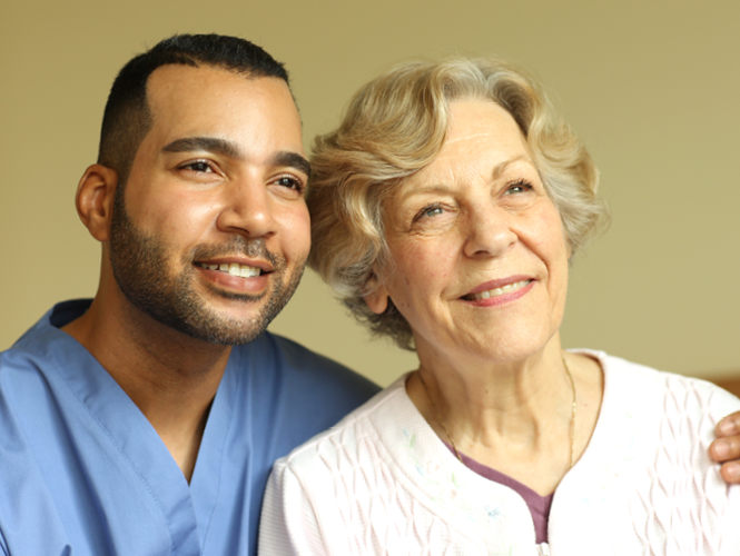 male providence hospice worker stands with female palliative care worker