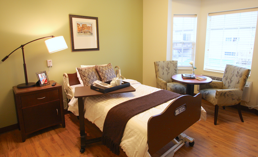 interior shot of victorian village nursing home room in small house