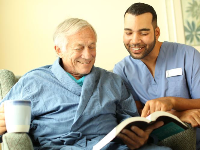 a male cna assists a male senior resident at park place st John