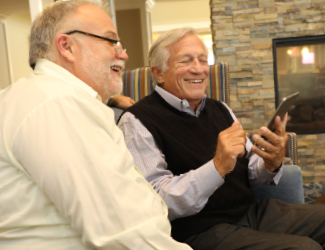 two senior men discuss independent living at park place st John