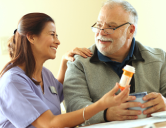 a female CNA assists male resident with medication