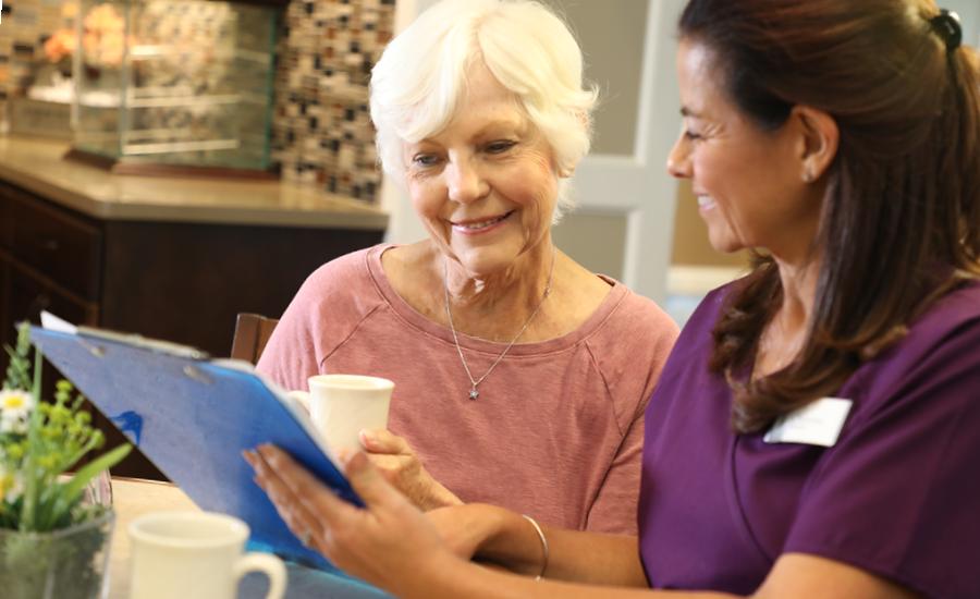 female geriatric care manager explains care plan to female senior
