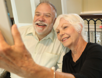 an older adult couple taking a selfie