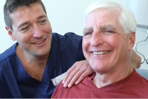 male therapist assists female rehab patient