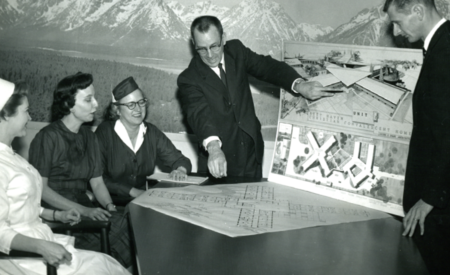 the founders of providence life services look at a model of the community