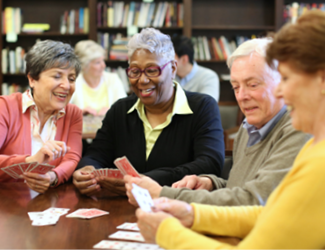 four residents gather together and play board games together