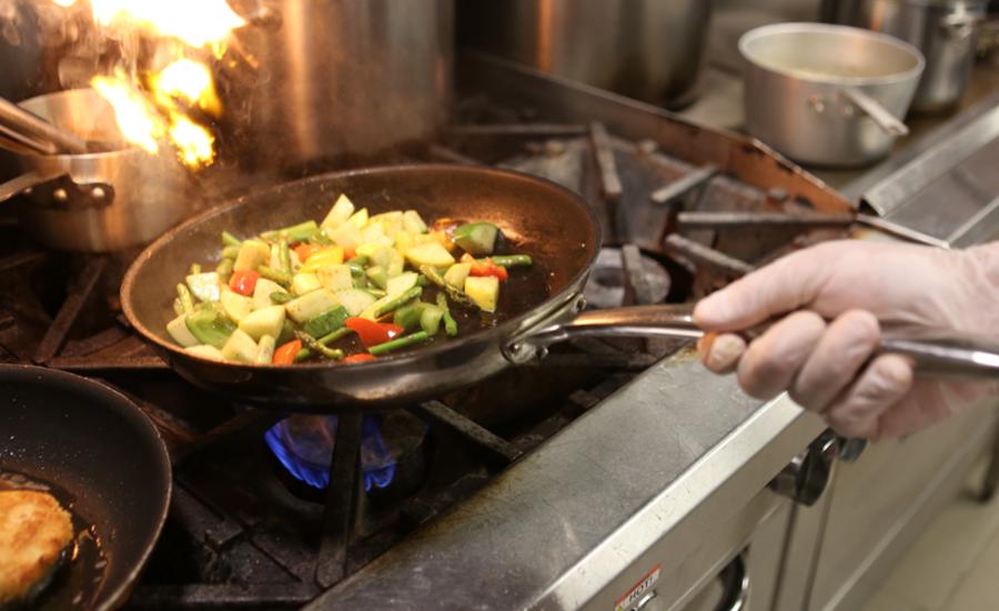 park place chef sautés vegetables over stove