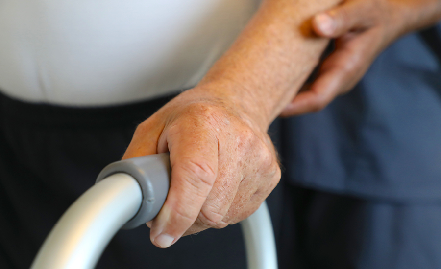 Hand grasping walker handle