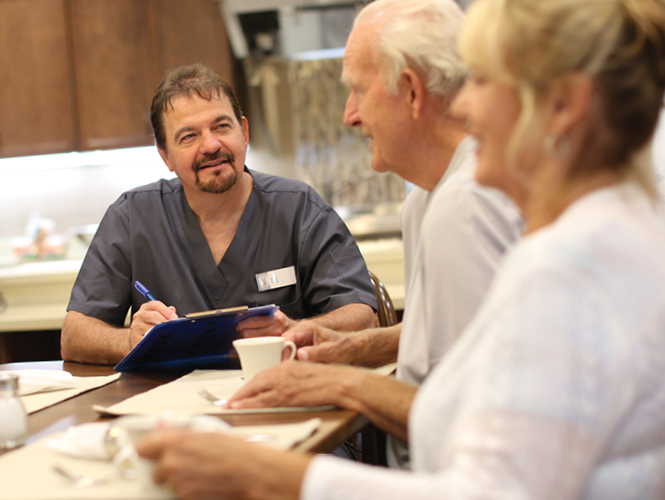 male cna discusses care plan with residents