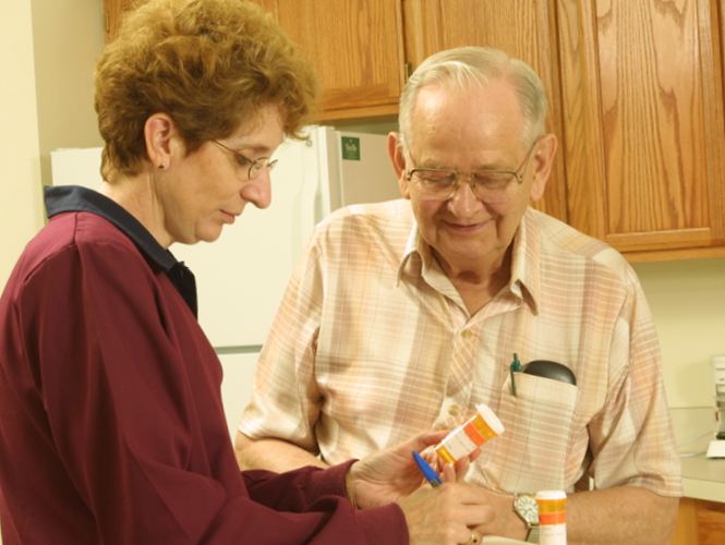 home healthcare worker helps senior man