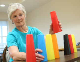 a senior woman completes occupational therapy activity at providence