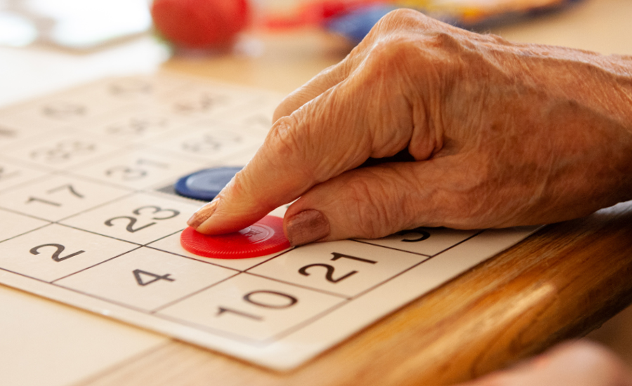 woman's hand shows playing bingo