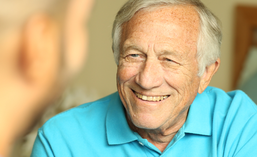 Male Assisted Living resident smiling at emerald meadows