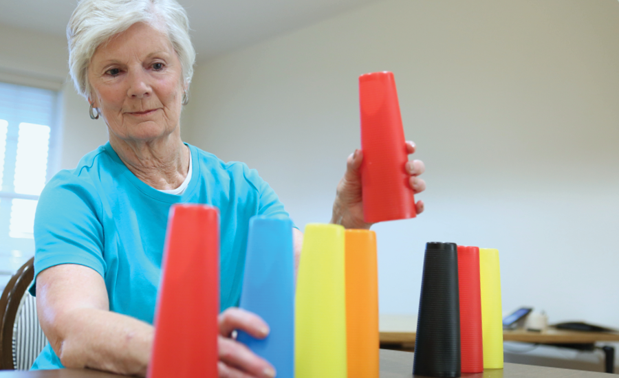 providence rehab patient moves cones for occupational therapy