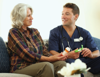 older adult female in transition to home program discusses care plan with male cna
