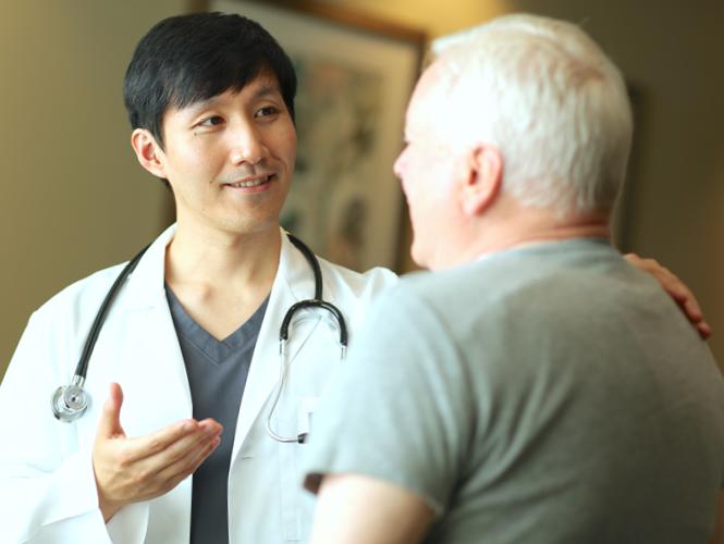 doctor explains hospice program to family member
