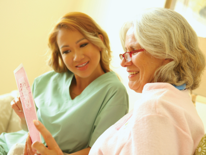 a CNA explains using an iPad with female resident