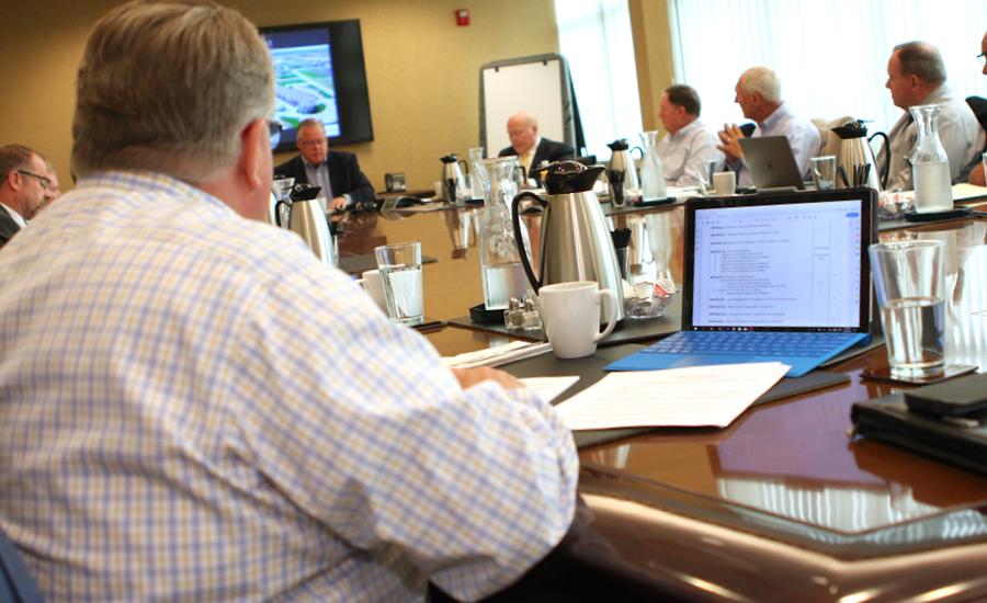 providence leadership at meeting sitting around board room table talking