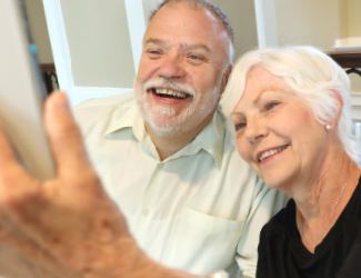 a senior couple take a selfie